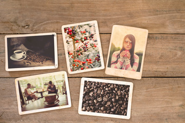 Coffee photo album on wood table. instant photo of film camera - vintage and retro style