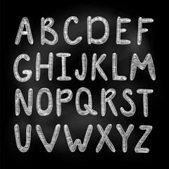 Alphabet. Sketch illustration. White chalk on a blackboard