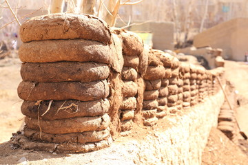 Fertilizer stacked and dried on a wall