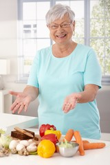 Happy granny preparing healthy food