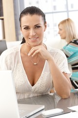 Closeup portrait of casual businesswoman at office