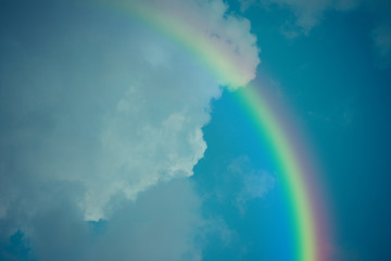 Blue sky cloud with rainbow , process in vintage style
