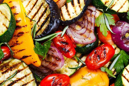 Grilled vegetables. On cutting dark board background