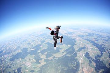 Female skydiver free falling above Leutkirch, Bavaria, Germany