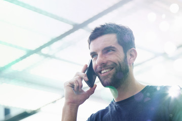 Mid adult man using smartphone