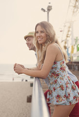 Young couple on Santa Monica pier, California, USA