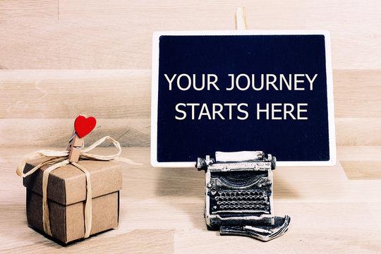 your journey starts here written on a chalkboard