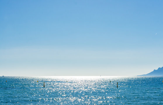 View of beautiful landscape: sea and sunny sky from Promenade de la Croisette, the Croisette and Port Le Vieux of Cannes, France Cote d'Azur