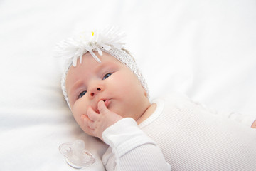 Little newborn girl lying on the bed