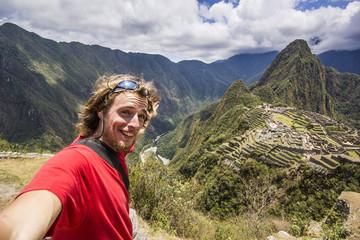 self-portrait of smiling man near machu-picchu in peru