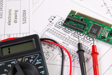 electrical engineering drawings, electronic board and digital multimeter