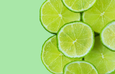 Healthy green background with lime slices