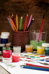 Colored pencils and paints - drawing tools, selective focus