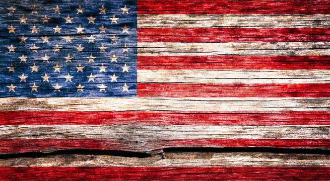 USA flag painted on the old cracked wood with worn-out paint. Grunge look.
