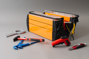 Toolbox and tools on a gray background