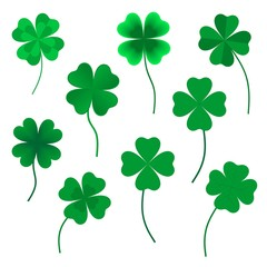 Set of green four leaf clovers in various shapes made up of a heart with green stems on a white background