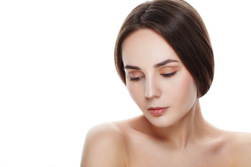 Beauty portrait of pretty girl with natural makeup. Beautiful spa woman touching her face. Perfect fresh skin. Pure beauty model girl. Youth and skin care concept