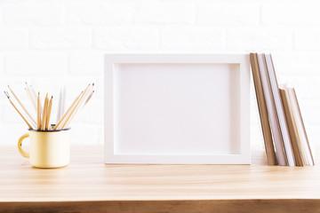 Desktop with iron mug and frame