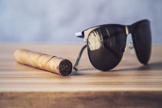 Sunglasses and cigar