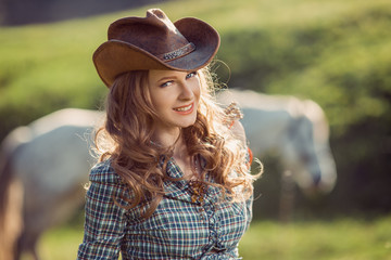 Horse and girl with cowboy hat