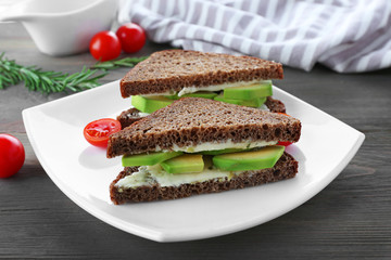 Avocado sandwich with tomatoes on a plate