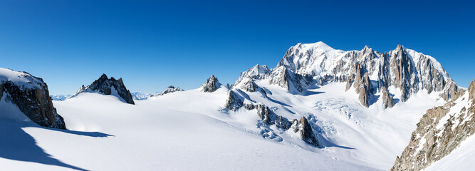 Mont Blanc, France: winter panorama on the east face from Geant Glacier. On the right the pinnacles of Mont Maudit and Mont Blanc du Tacul.