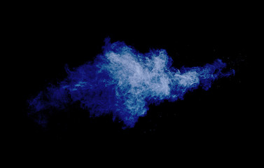 Cloud of powder on dark blue background
