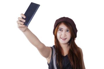 Trendy teenage girl making selfie photo