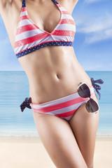 Woman posing at the seaside