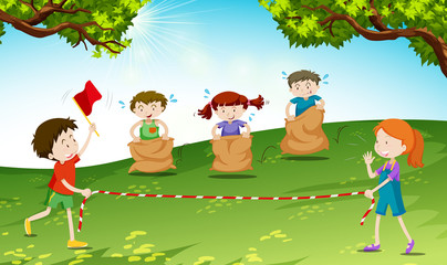 Children play jumping sack in the park