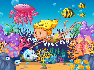 Girl swimming with sea animals underwater
