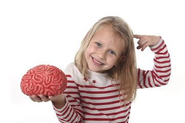 young beautiful girl 6 to 8 years old playing with rubber brain having fun learning science concept