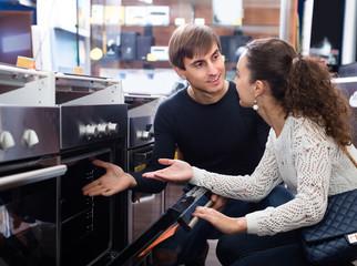 Customers choosing new oven.