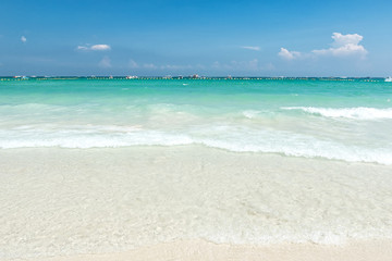 Wall Mural - Beautiful Water clear at the sandy beach with blue sky