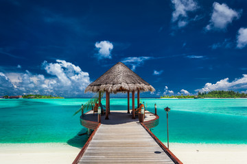Fotobehang Bestsellers Traditional boat jetty in luxury resort of Maldives, Indian Ocea