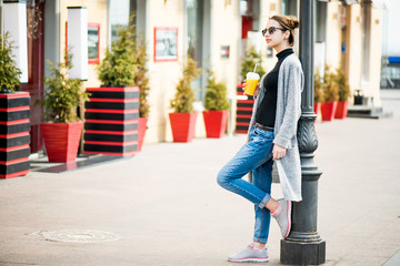 Foto op Aluminium Zuid-Amerika land Portrait of young stylish hipster girl walking on the street, drinking tasty smoothie.