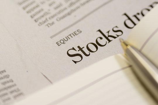 Close up of newspaper, focus in STOCK