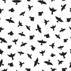 Birds seamless pattern. Black silhouettes of birds.