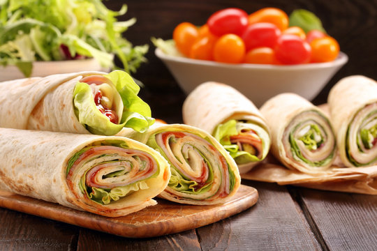 Fresh tortilla wraps with ham cheese and vegetables
