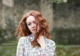 Portrait of red-haired girl with freckles