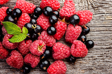 fresh berries on a wooden rustic tablel closeup