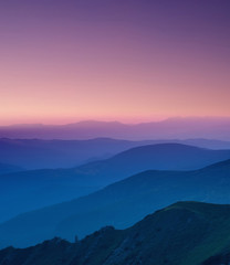 Hills lines in mountain valley during sunset. Natural summer mountain landscape