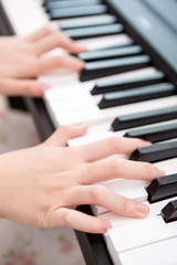 the woman  hands playing piano