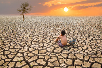 Child sit on cracked earth  old man sit on cracked earth in the