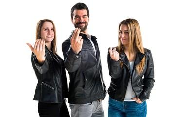 People  making coming gesture
