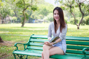 Portrait of thai adult beautiful girl read a book