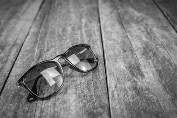 Glasses on old wooden table