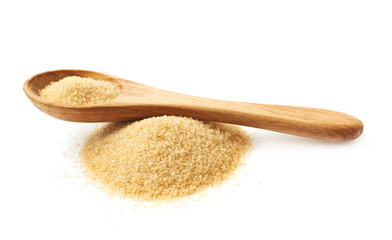Spoon over pile of sugar