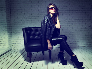 fashion model in sunglasses, black leather jacket, leather pants