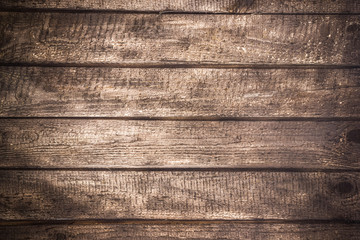 Grunge stained wood background.